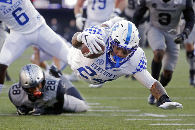 Kentucky running back Christopher Rodriguez Jr. (24) dives into the end zone for a touchdown on a 22-yard run against Vanderbilt in the first half of an NCAA college football game Saturday, Nov. 16, 2019, in Nashville, Tenn. (AP Photo/Mark Humphrey)