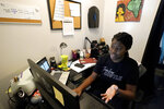 A Chicago charter school teacher Angela McByrd works on her laptop to teach remotely from her home in Chicago, Thursday, Sept. 24, 2020. Most students in Illinois have been starting remote learning this fall, according to results from an Illinois State Board of Education survey. (AP Photo/Nam Y. Huh)