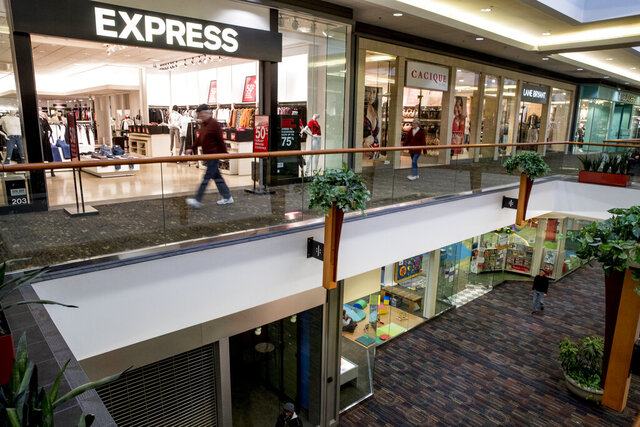 FILE - In this Jan. 22, 2020, file photo a store front is closed below an Express retail clothing store in Valley West Mall in West Des Moines, Iowa. On Tuesday, Jan. 28, the Conference Board reports on U.S. consumer confidence for January. (AP Photo/Andrew Harnik, File)