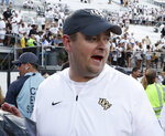 """FILE - In this Sept. 29, 2018, file photo, Central Florida head coach Josh Heupel leaves the field after defeating Pittsburgh in an NCAA college football game, in Orlando, Fla. No. 12 UCF feels criticism of its schedule is invalid and that the American Athletic Conference is proving that as the season progresses. """"We're going into week five. People are going to get a chance to watch us as we go down the road,'' coach Josh Heupel said, responding to whether he believes he should lobby for a higher ranking on behalf of the defending AAC champions. (AP Photo/John Raoux, File)"""