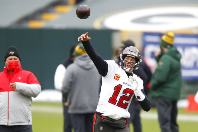 Tampa Bay Buccaneers quarterback Tom Brady warms up before the NFC championship NFL football game between the Tampa Bay Buccaneers and Green Bay Packers in Green Bay, Wis., Sunday, Jan. 24, 2021. (AP Photo/Matt Ludtke)