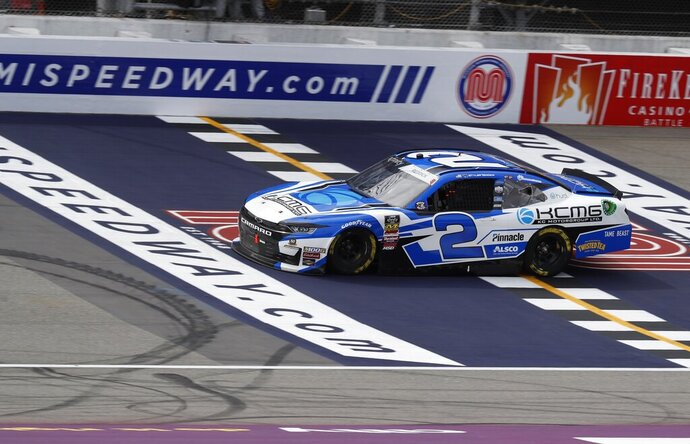 Tyler Reddick crosses the finish line to win the NASCAR Xfinity Series auto race at Michigan International Speedway, Saturday, June 8, 2019, in Brooklyn, Mich. (AP Photo/Carlos Osorio)