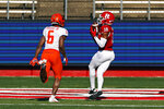 Rutgers wide receiver Bo Melton (18) scores a touchdown in front of Illinois defensive back Tony Adams during the first half of an NCAA college football game, Saturday, Nov. 14, 2020, in Piscataway, N.J. (AP Photo/Adam Hunger)