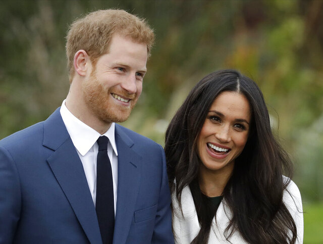 FILE - In this Monday Nov. 27, 2017 file photo, Britain's Prince Harry and his fiancee Meghan Markle pose for photographers during a photocall in the grounds of Kensington Palace in London. As the British royal family wrestles with the future roles of Prince Harry and his wife Meghan, it could look to Europe for examples of how princes and princesses have tried to carve out careers away from the pomp and ceremony of their families' traditional duties. (AP Photo/Matt Dunham, File)