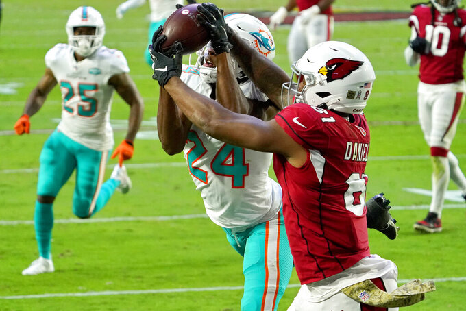 Arizona Cardinals tight end Darrell Daniels (81) pulls in a touchdown pass as Miami Dolphins cornerback Byron Jones (24) defends during the second half of an NFL football game, Sunday, Nov. 8, 2020, in Glendale, Ariz. (AP Photo/Rick Scuteri)