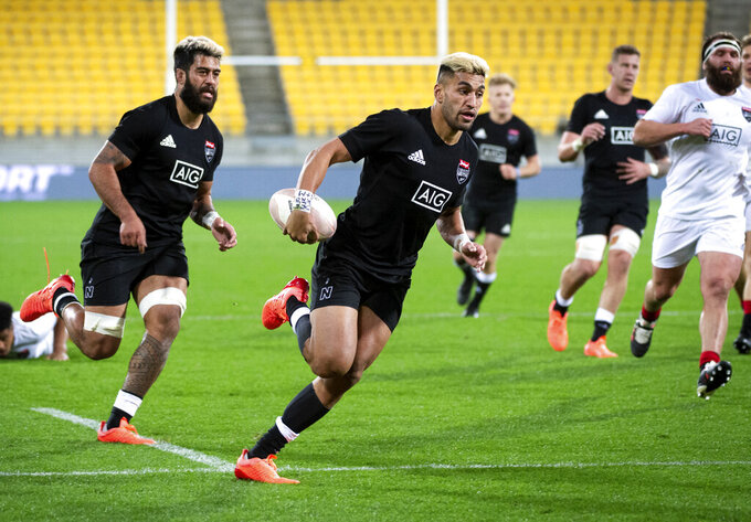 Reiko Ioane runs in to score a try during the North vs South rugby game in Wellington, New Zealand, Saturday, Sept. 5, 2020. The All Blacks which will be named Sunday, Sept 6. (Elias Rodriguez/Photosport via AP)
