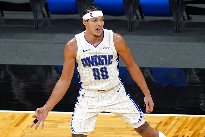 Orlando Magic forward Aaron Gordon gestures with his hand holding out 3 fingers after sinking a 3-point shot against the Cleveland Cavaliers during the second half of an NBA basketball game, Monday, Jan. 4, 2021, in Orlando, Fla. (AP Photo/John Raoux)