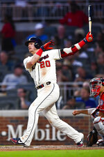Atlanta Braves' Josh Donaldson watches his home run sail over left center field during the sixth inning of a baseball game against the Washington Nationals, Sunday, July 21, 2019, in Atlanta. (AP Photo/John Amis)