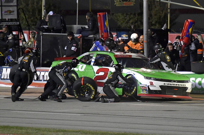Tyler Reddick makes a pit stop during the NASCAR Xfinity auto race at Texas Motor Speedway in Fort Worth, Texas, Saturday, Nov. 2, 2019. (AP Photo/Larry Papke)
