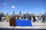 Gov. J.B. Pritzker signs the state's Climate and Equitable Jobs Act at Shedd Aquarium in Chicago on Wednesday, Sept. 15, 2021. (Anthony Vazquez/Chicago Sun-Times via AP)