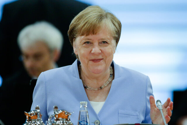 German Chancellor Angela Merkel attends a special cabinet meeting of the German government about the a stimulus program to booster the German economy after the coronavirus lockdown, at the chancellery in Berlin, Germany, Friday, June 12, 2020. (AP Photo/Markus Schreiber, Pool)