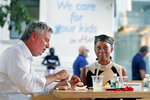 New York Mayor Bill de Blasio, left, dines with his wife Chirlane McCray in an outdoor booth at Melba's restaurant in Harlem on the first day of the Phase 2 reopening of the city during the  coronavirus pandemic Monday, June 22, 2020, in New York. (AP Photo/Kathy Willens)