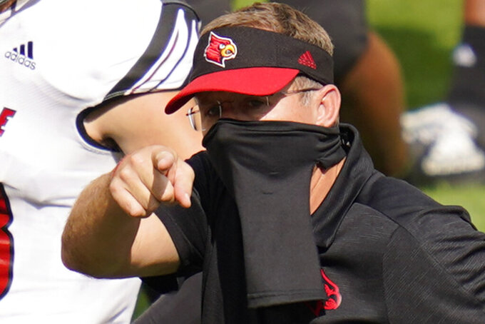 FILE - Louisville head coach Scott Satterfield points towards the Pittsburgh bench after an NCAA college football game in Pittsburgh, in this Saturday, Sept. 26, 2020, file photo. Satterfield's Cardinals play their regular-season finale against Wake Forest on Saturday, Dec. 12. (AP Photo/Keith Srakocic, File)