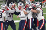 New England Patriots kicker Nick Folk, center, celebrates with teammates after kicking the winning field goal during the second half of an NFL football game against the New York Jets, Monday, Nov. 9, 2020, in East Rutherford, N.J. (AP Photo/Bill Kostroun)