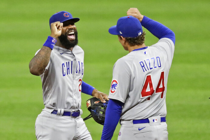 Chicago Cubs' Jason Heyward, left, is congratulated by Anthony Rizzo after the Cubs defeated the Cleveland Indians 7-1 in a baseball game, Tuesday, Aug. 11, 2020, in Cleveland. (AP Photo/Tony Dejak)