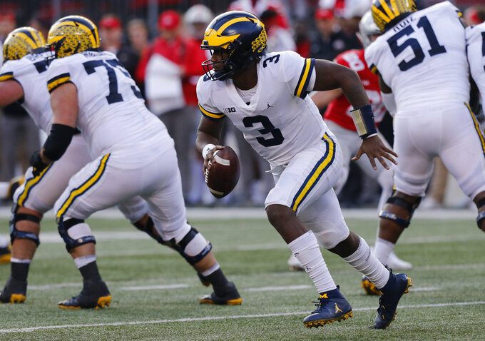 Michigan quarterback Joe Milton runs the ball against Ohio State during the second half of an NCAA college football game Saturday, Nov. 24, 2018, in Columbus, Ohio. Ohio State beat Michigan 62-39. (AP Photo/Jay LaPrete)