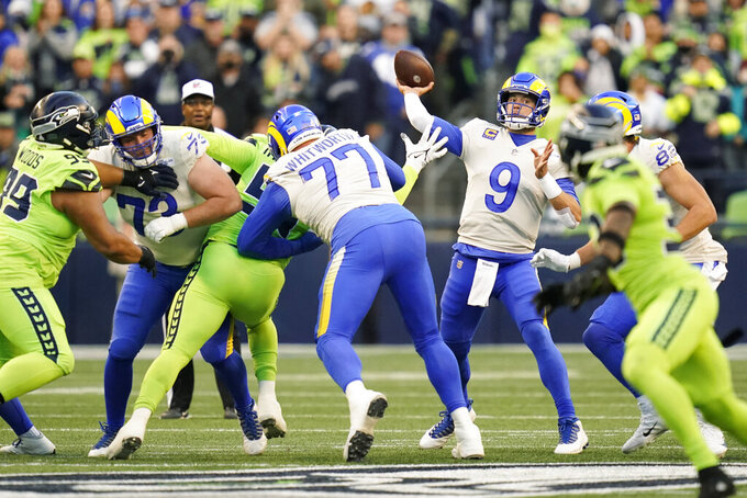 Los Angeles Rams quarterback Matthew Stafford (9) passes against the Seattle Seahawks during the first half of an NFL football game, Thursday, Oct. 7, 2021, in Seattle. (AP Photo/Elaine Thompson)