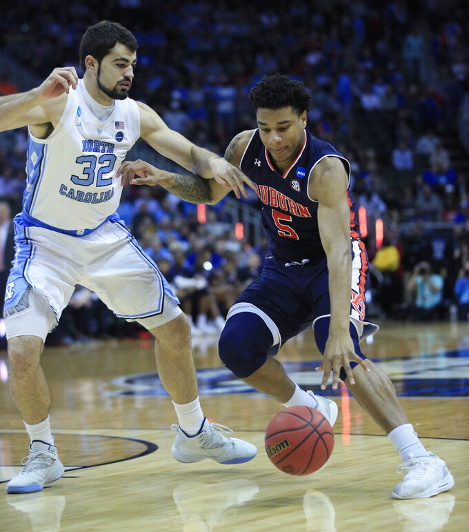 Auburn's Chuma Okeke (5) dribbles as North Carolina's Luke Maye (32) defends during the first half of a men's NCAA tournament college basketball Midwest Regional semifinal game Friday, March 29, 2019, in Kansas City, Mo. (AP Photo/Orlin Wagner)