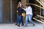Jenny Cudd, front, a flower shop owner and former Midland mayoral candidate, and Eliel Rosa, rear, leave the federal courthouse in Midland, Texas, Wednesday, Jan. 13, 2021. The FBI arrested Cudd and Rosa on Wednesday in connection with the Jan. 6 insurrection at the U.S Capitol.  (Jacob Ford/Odessa American via AP)