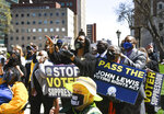 People rally outside of the Capitol in Lansing, Mich., Tuesday, April 13, 2021, during a rally to support voting rights & end voter suppression. The event was sponsored by the Detroit branch of the NAACP. (Matthew Dae Smith /Lansing State Journal via AP)