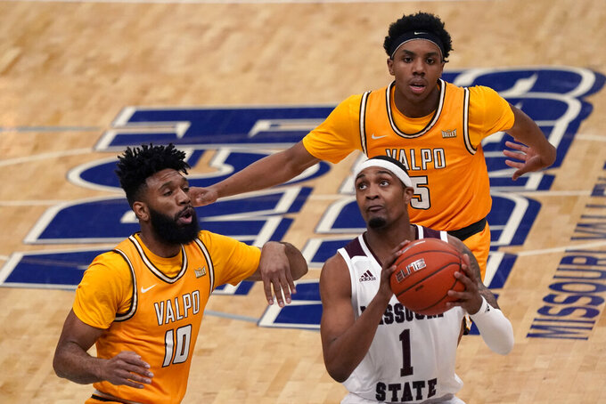 Missouri State's Isiaih Mosley (1) heads to the basket as Valparaiso's Eron Gordon (10) and Donovan Clay (5) defend during the first half of an NCAA college basketball game in the quarterfinal round of the Missouri Valley Conference men's tournament Friday, March 5, 2021, in St. Louis. (AP Photo/Jeff Roberson)