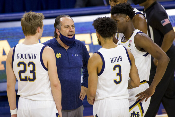 Notre Dame head coach Mike Brey talks to his players during the first half of an NCAA college basketball game against Florida State on Saturday, March 6, 2021, in South Bend, Ind. Notre Dame won 83-73. (AP Photo/Robert Franklin)