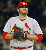 FILE - In this Sept. 23, 2017, file photo, St. Louis Cardinals starting pitcher Lance Lynn collects himself after giving up a triple with bases loaded to Pittsburgh Pirates' Jordy Mercer in the first inning of a baseball game, in Pittsburgh. In a historically slow market, players and management are feuding publicly about riches and rules, and teams seemingly are seeking bargains like shoppers awaiting a closeout.  Job-seekers include pitchers Alex Cobb and Lance Lynn; reliever Greg Holland; infielder Eduardo Nunez; outfielders Carlos Gomez and Carlos Gonzalez; and catcher Jonathan Lucroy. (AP Photo/Gene J. Puskar, File)