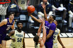 Northwestern guard Chase Audige (1) shoots over Purdue forward Mason Gillis during the first half of an NCAA college basketball game in West Lafayette, Ind., Saturday, Feb. 6, 2021. (AP Photo/Michael Conroy) 4:54