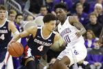 Gonzaga's Ryan Woolridge (4) tries to get past Washington's Elijah Hardy (10) in the first half of an NCAA college basketball game Sunday, Dec. 8, 2019, in Seattle. (AP Photo/Elaine Thompson)
