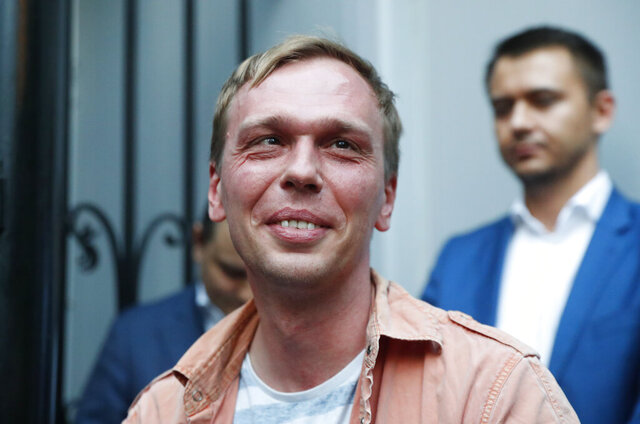 FILE- In this file photo taken on Tuesday, June 11, 2019, Prominent Russian investigative journalist Ivan Golunov, leaves a Investigative Committee building in Moscow, Russia. Russia's Investigative Committee on Wednesday detained five former police officers involved in a controversial drug arrest of a prominent investigative journalist last year. Ivan Golunov, 37, was arrested in June 2019 in Moscow on drug-dealing charges he rejected as a sham. (AP Photo/Pavel Golovkin, File)