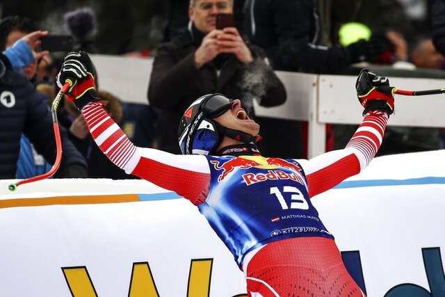 Austria's Matthias Mayer celebrates in the finish area after completing an alpine ski, men's World Cup downhill, in Kitzbuehel, Austria, Saturday, Jan. 25, 2020. (AP Photo/Marco Trovati)