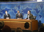 """This image released by NBC shows, from left, Colin Jost, Michael Che, and host Elon Musk as financial expert Lloyd Ostertag during the """"Weekend Update"""" sketch on """"Saturday Night Live,"""" in New York on May 8, 2021. (Will Heath/NBC via AP)"""