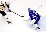 Boston Bruins right wing Ondrej Kase (28) moves in on Tampa Bay Lightning goaltender Andrei Vasilevskiy (88) during the first period in Game 1 of an NHL hockey second-round playoff series, Sunday, Aug. 23, 2020, in Toronto. (Frank Gunn/The Canadian Press via AP)