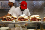 FILE - In this May 11, 2017, file photo, orders are ready to go out at Katz's Delicatessen in New York. The deli was featured in the 1989 film
