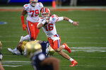 Clemson quarterback Trevor Lawrence (16) runs the ball during the first half of the Atlantic Coast Conference championship NCAA college football game against Notre Dame, Saturday, Dec. 19, 2020, in Charlotte, N.C. (AP Photo/Brian Blanco)