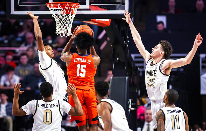 Clemson forward John Newman III (15) shoots over defense from Wake Forest forward Ody Oguama, top left, during an NCAA college basketball game Saturday, Feb. 1, 2020, in Winston-Salem, N.C. (Andrew Dye/The Winston-Salem Journal via AP)