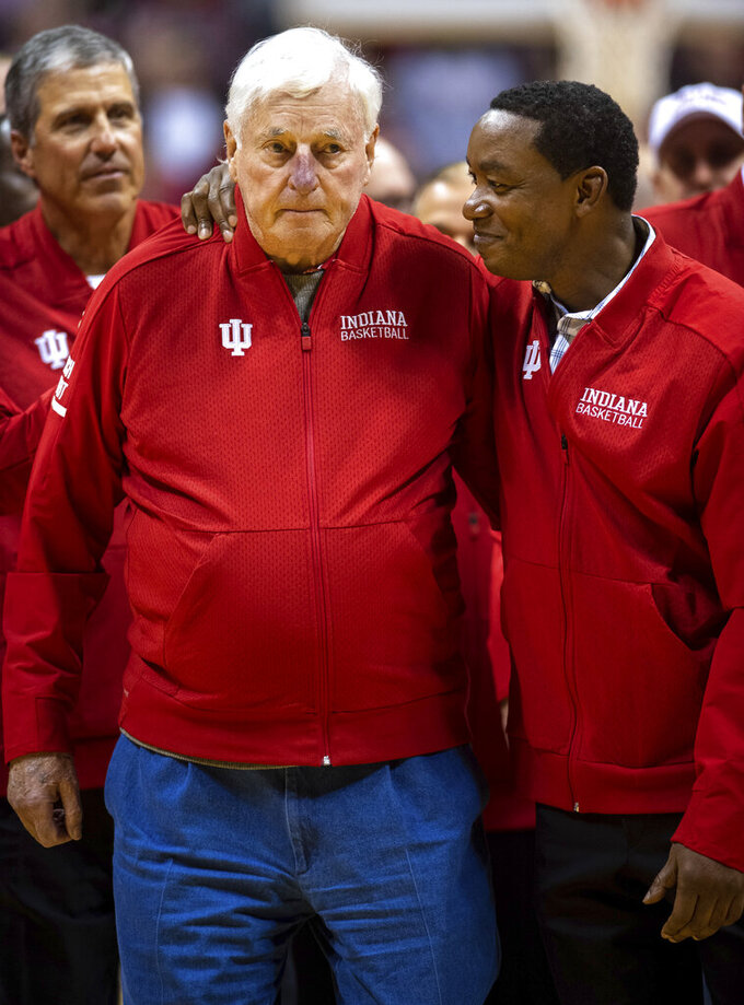 Former Indiana basketball head coach Bobby Knight, left, makes his first appearance at Indiana University since his dismissal in September of 2000. Knight, along with former player Isiah Thomas, right, are on the court during a ceremony with the Indiana players of the 1980 Big Ten championship team the halftime of an NCAA college basketball game, Saturday, Feb. 8, 2020, in Bloomington, Ind. (AP Photo/Doug McSchooler)