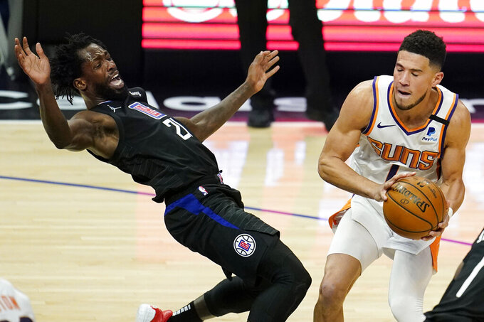 Los Angeles Clippers guard Patrick Beverley, left, falls back while defending on Phoenix Suns guard Devin Booker during the first half of an NBA basketball game Thursday, April 8, 2021, in Los Angeles. (AP Photo/Marcio Jose Sanchez)