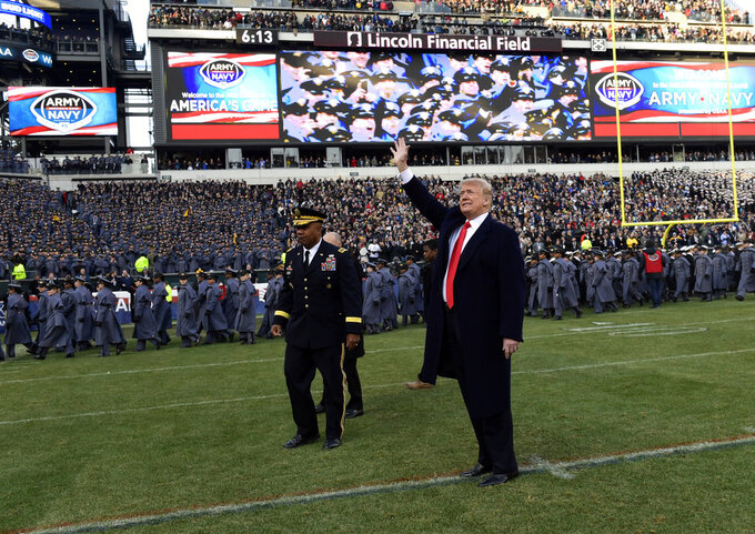 President Donald Trump waves to the crowd as the walks off of the field before the start of the Army-Navy NCAA college football game in Philadelphia, Saturday, Dec. 8, 2018. (AP Photo/Susan Walsh)