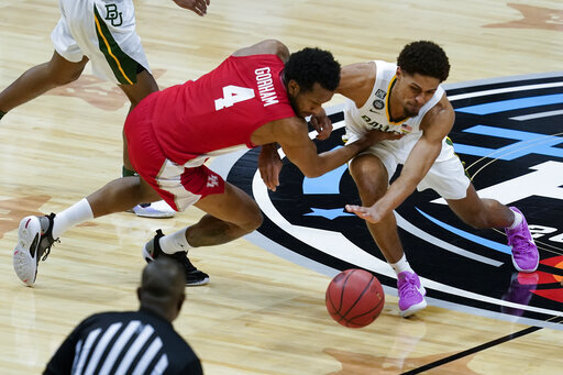 Houston forward Justin Gorham (4) fights for a loose ball with Baylor guard MaCio Teague, right, during the first half of a men's Final Four NCAA college basketball tournament semifinal game, Saturday, April 3, 2021, at Lucas Oil Stadium in Indianapolis. (AP Photo/Darron Cummings)