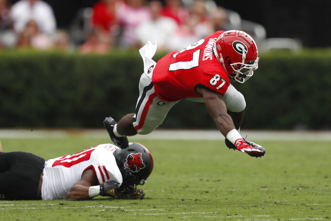 Georgia wide receiver Tyler Simmons (87) is stopped by Arkansas State defensive back Detravion Green (20) as he returns a punt in the first half of an NCAA college football game Saturday, Sept. 14, 2019, in Athens, Ga. (AP Photo/John Bazemore)