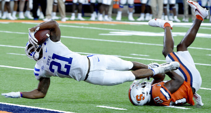 Duke running back Mataeo Durant (21) comes up short of the goal line against Syracuse during an NCAA college football game,  Saturday, Oct 10, 2020, at the Carrier Dome in Syracuse, N.Y. (Dennis Nett/The Post-Standard via AP)