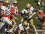 Clemson linebacker Baylon Spector (10) tackles Boston College defensive back Jio Holmes (26) during the second half of an NCAA college football game  Saturday, Oct. 31, 2020, in Clemson, S.C. (Josh Morgan/Pool Photo via AP)