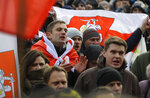 Protesters attend a rally in downtown Minsk, Belarus, Saturday, Dec. 7, 2019. More than 1,000 opposition demonstrators are rallying in Belarus to protest closer integration with Russia. Saturday's protest in the Belarusian capital comes as Belarusian President Alexander Lukashenko is holding talks with Russian President Vladimir Putin in Sochi on Russia's Black Sea coast. (AP Photo/Sergei Grits)