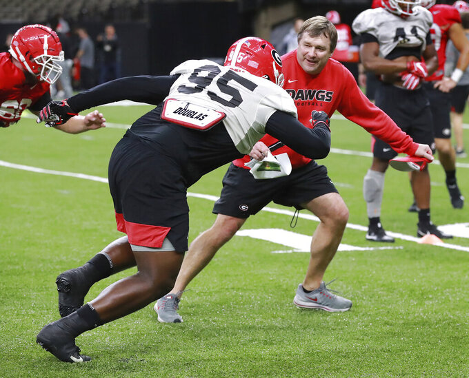 Georgia head coach Kirby Smart runs defensive lineman Devonte Wyatt through a drill during team practice for the Sugar Bowl at Mercedes-Benz Superdome on Saturday, December 28, 2019, in New Orleans. (Curtis Compton/Atlanta Journal-Constitution via AP)