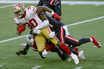 San Francisco 49ers running back Jeff Wilson Jr. gains yardage against the New England Patriots in the first half of an NFL football game, Sunday, Oct. 25, 2020, in Foxborough, Mass. (AP Photo/Steven Senne)
