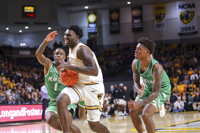 Virginia Commonwealth's Vince Williams (10) drives past North Texas' Umoja Gibson (1) and Javion Hamlet (3) during the first half of an NCAA college basketball game in Richmond, Va., Friday, Nov. 8, 2019. (AP Photo/Parker Michels-Boyce)