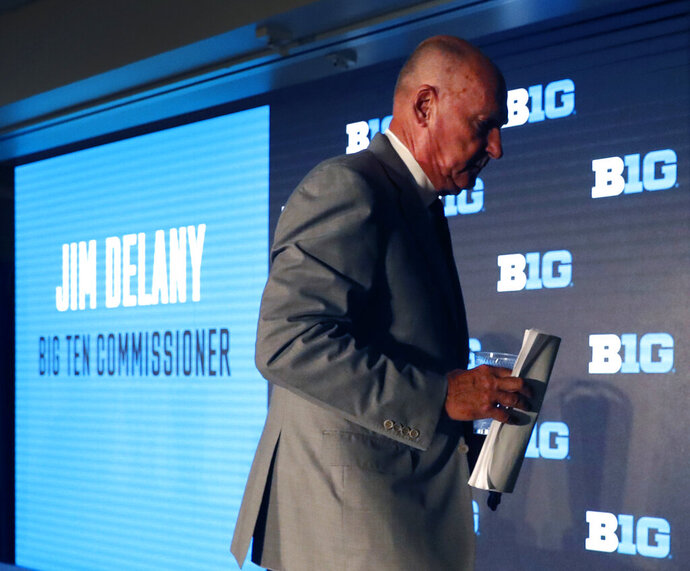 Big Ten Commissioner Jim Delany walks away from the podium at the Big Ten Conference NCAA college football media days Thursday, July 18, 2019, in Chicago. Delany will retire on Jan. 1, 2020, with Minnesota Vikings executive Kevin Warren succeeding him. (AP Photo/Charles Rex Arbogast)