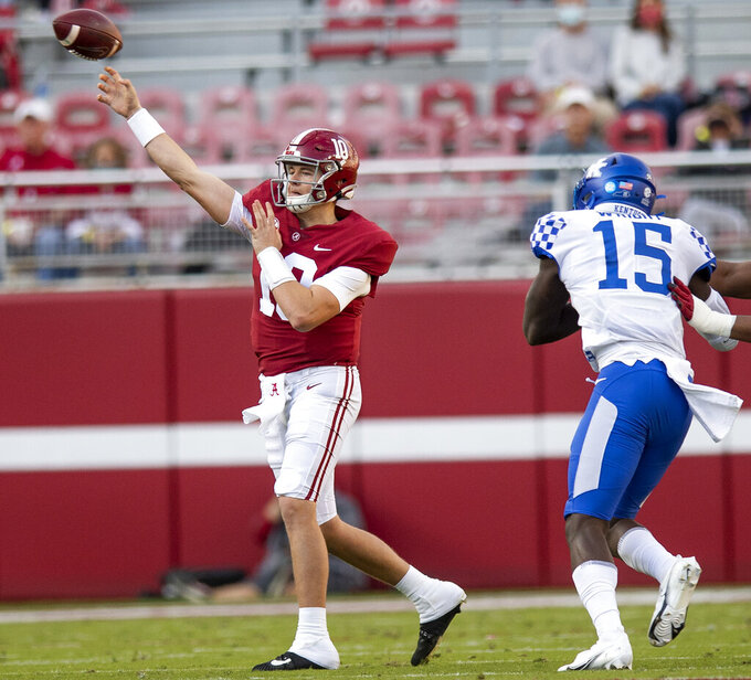 Alabama quarterback Mac Jones (10) passes against Kentucky during an NCAA college football game in Tuscaloosa, Ala., Saturday, Nov. 21, 2020. (Mickey Welsh/The Montgomery Advertiser via AP)