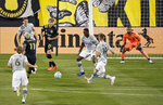 Columbus Crew forward Gyasi Zardes (11) takes a shot on goal against Montreal Impact goalkeeper Clement Diop, right during the first half of an MLS soccer match in Columbus, Ohio, Wednesday, Oct. 7, 2020. (Kyle Robertson/The Columbus Dispatch via AP)